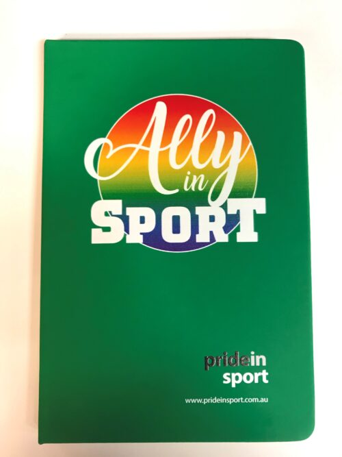 Image is of a bright green notebook with a large round rainbow emblem behind the words Ally in Sport in white centred towards the top. A small Pride in Sport logo is at the bottom of the cover.